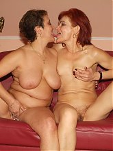 Horny grannies Steph and Julianna show off their sexy asses and do a little kinky lesbian show
