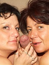 Sexy Older gals Marsha and Agnes got together to share a cock and take it in their hairy cunts