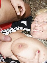 Big titted mama getting cock in the woods