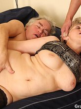 Old babe with wrinkled pussy is fucked by two guys at once and loves it all