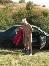 Sexy granny seductress convinces the young man to pull the car over and fuck her pussy