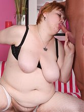 Hefty redhead chick Elisha works a cock with her lips before taking it inside her bushy cunt