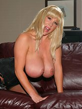 Kandi Cox uses her pair of huge tits to work a cock during her explicit live cam session