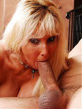 Tia Gunn unleashes her pair of big mature tits while sucking and fucking a cock live
